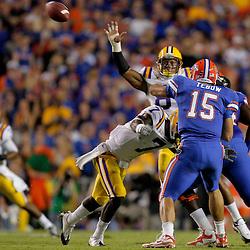 Oct 10, 2009; Baton Rouge, LA, USA;  LSU Tigers cornerback Patrick Peterson (7) hits Florida Gators quarterback Tim Tebow (15) as he throws during the first quarter at Tiger Stadium. Mandatory Credit: Derick E. Hingle-US PRESSWIRE