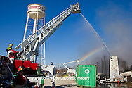 63818-02305 Firefighters extinguishing warehouse fire using aerial ladder truck, Salem, IL