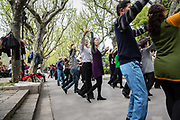 People pair up to dance in a group at Fuxing Park in Shanghai, China, on Sunday, April 10, 2016. An rapidly ageing demographic is one of the main challenges facing China as society is greying before the country became a developed nation.