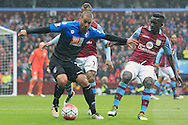 Lewis Grabban of Bournemouth (L) in action with Idrissa Gana of Aston Villa ®.<br /> Barclays Premier League match, Aston Villa v AFC Bournemouth at Villa Park in Birmingham, The Midlands on Saturday 09th April 2016.<br /> Pic by Ian Smith, Andrew Orchard Sports Photography.