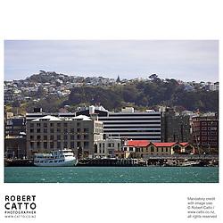 The New Zealand Stock Exchange building and boatsheds seen from Lambton Harbour, Wellington, New Zealand.<br />