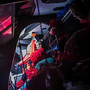 Leg 3, Cape Town to Melbourne, day 03, Watch partners Blair Tuke and Pablo Arrarte get dressed for watch on board MAPFRE. Photo by Jen Edney/Volvo Ocean Race. 12 December, 2017.