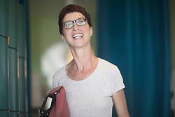 Mature woman standing in the office and laughing, Freiburg im Breisgau, Baden-W¸rttemberg, Germany