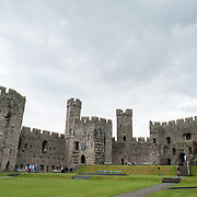 Ramparts seen from the interior courtyard at Caernarfon Castle in northwest Wales. A castle originally stood on the site dating back to the late 11th century, but in the late 13th century King Edward I commissioned a new structure that stands to this day. It has distinctive towers and is one of the best preserved of the series of castles Edward I commissioned.