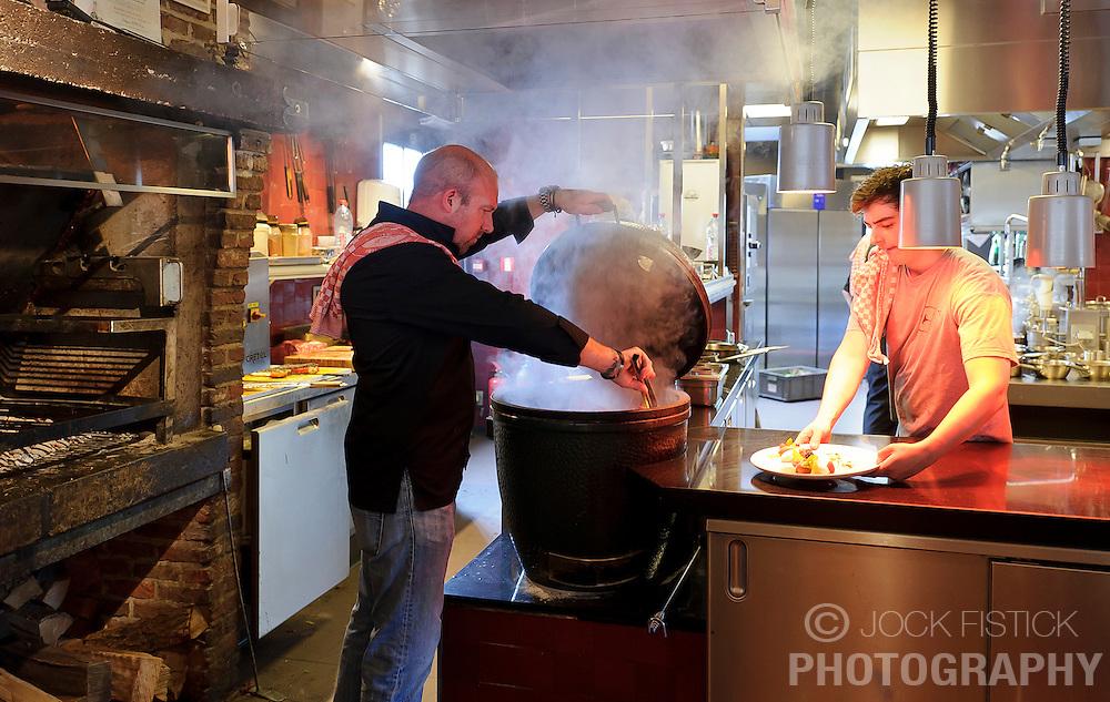 "MALDEGEM, BELGIUM - JUNE-18-2011 - The Big Green Egg is one Peter De Clercq's favorite grills. De Clercq says, ""You can't beat the flavor of wood."" (Photo © Jock Fistick)"