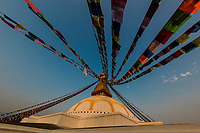 Prayer flags ring the massive stupa of the Boudhanath Temple. It is the largest stupa in Nepal and the holiest Tibetan Buddhist temple outside Tibet. It is the center of Tibetan culture in Kathmandu, Nepal.