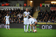 Chico Flores and Jonjo Shelvey work out who is going to take the free kick for Swansea City.<br /> UEFA Europa league match, Swansea city v FC Kuban Krasnodar at the Liberty Stadium in Swansea, South Wales on Thursday 24th October 2013. pic by Phil Rees, Andrew Orchard sports photography,