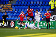 Romaine Saweys of Walsall skips over Tranmere Rovers James Rowe. Skybet football league 1 match, Tranmere Rovers v Walsall at Prenton Park in Birkenhead, England on Saturday 11th Jan 2014.<br /> pic by Chris Stading, Andrew Orchard sports photography.