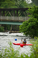 "A kayaker through the course during ""Winni River Days"" whitewater festival at Trestle View Park in Franklin Saturday afternoon.  (Karen Bobotas/for the Laconia Daily Sun)"