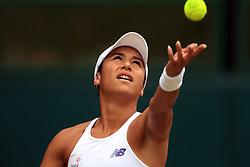 Heather Watson and Henri Kontinen (out of pic) during their mixed doubles final's match against Jamie Murray and Martina Hingis on day thirteen of the Wimbledon Championships at The All England Lawn Tennis and Croquet Club, Wimbledon.