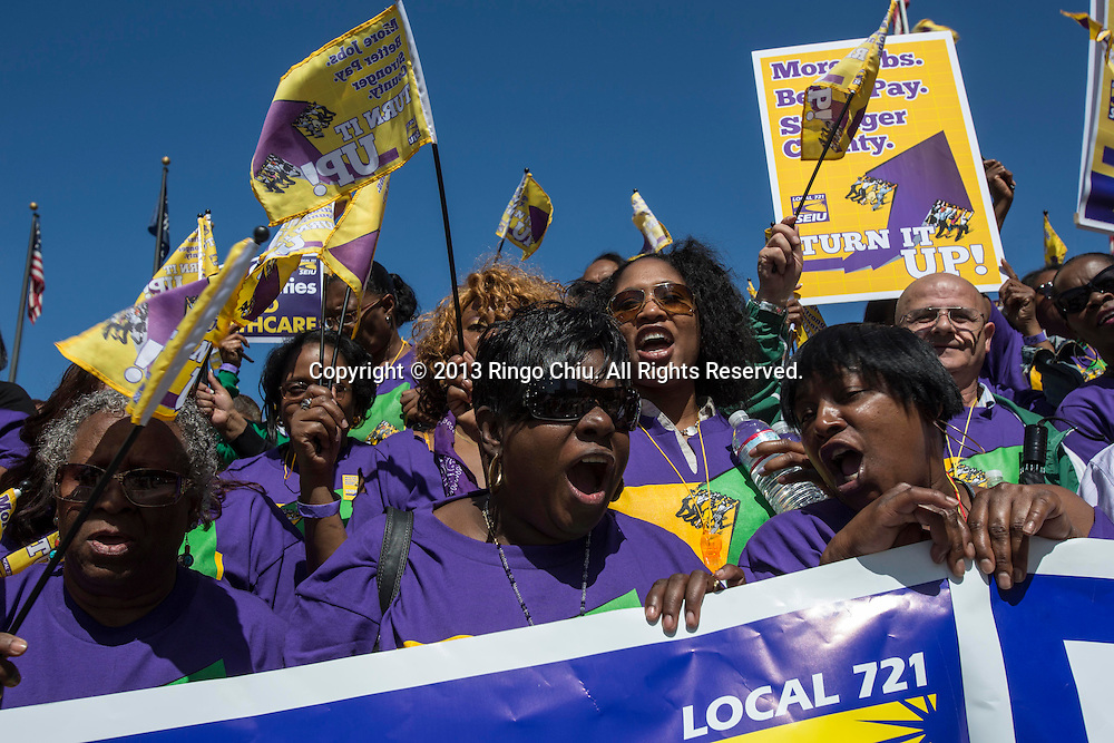 Thousands workers, including county nurses, librarians, social workers, public health workers, probation officers and park.employees, rally to demand higher wages, expanded Medicaid coverage to millions of Californians, on Tuesday April 16, 2013 in downtown Los Angeles, California. (Photo by Ringo Chiu/PHOTOFORMULA.com).