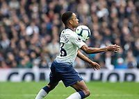 Football - 2018 / 2019 Premier League - Tottenham Hotspur vs. Huddersfield Town<br /> <br /> Kyle Walker-Peters(Tottenham FC)  brings the high ball under control with his chest at The Tottenham Hotspur Stadium.<br /> <br /> COLORSPORT/DANIEL BEARHAM