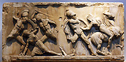 Slab from a frieze of the Mausoleum showing a battle between Lapiths and Centaurs Found built into the walls of the castle of St Peter, Bodrum about 350 BC The Centaurs were invited to the wedding of the Lapith king Perithoos, but they became inebriated and tried to carry off the Lapith women.