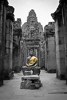 A Buddha Statue in the exterior gallery of The Bayon temple in the walled city of Angkor Thom, Siem Reap, Cambodia