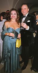 MR & MRS RAINER ZEITZ he is the art dealer, at a dinner in London on 30th November 1998.MMK 67