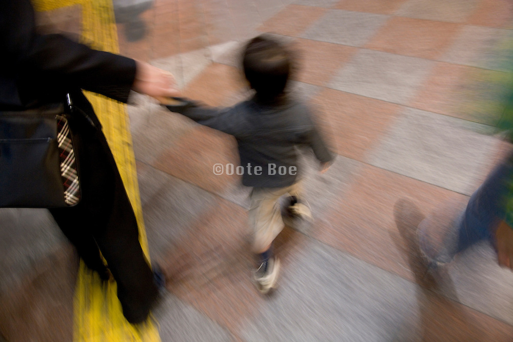 businessman walking with his child late in the evening
