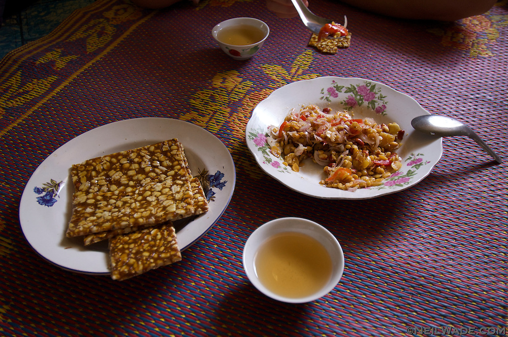 A sanck of peanut brittle and tea salad is served to guests in Myanmar.