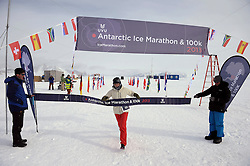 © Licensed to London News Pictures. Union Glacier, Antarctica. Great Britains FIONA OAKES at the finish line after winning the women's race in the 9th edition of the Antarctic Ice Marathon in record time. The Ice Marathon took place at Union Glacier, Antarctica, and is recognised as the world's southernmost marathon and the only official running event within the  Antarctic Circle, taking place just a few hundred miles from the South Pole at the foot of the Ellsworth Mountains. Temperatures were an ice cool -21C when the event got underway at 13:10 GMT on Wednesday 20 November. A total of 56 athletes from 21 countries took part in the ninth edition of the event, which is  an essential race for marathon runners seeking to join the Seven Continents Marathon Club. Photo credit: Mike King/LNP