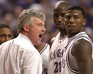 Kansas State head coach Jim Wooldridge (L) argues with an official, as David Hoskins (R) looks on at Bramlage Coliseum in Manhattan, Kansas, February 4, 2006.  Oklahoma State defeated K-State 63-61.