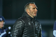 Lincoln City Michael Appleton walking off the pitch during the EFL Sky Bet League 1 match between AFC Wimbledon and Lincoln City at the Cherry Red Records Stadium, Kingston, England on 2 November 2019.