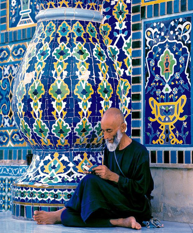 A man reads his Koran at the Shrine to Hazrat Ali in Mazar-i-Sharif, Afghanistan.