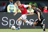 ALKMAAR - 16-09-2012 - voetbal Eredivisie - AZ - Roda JC, AFAS Stadion, 4-0, debuut voor AZ speler Markus Henriksen (l), Roda JC Kerkrade speler Mark Jan Fledderus (r).