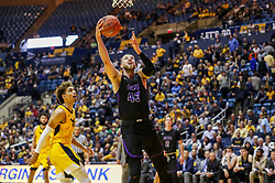 Mar 20, 2019; Morgantown, WV, USA; Grand Canyon Antelopes forward Michael Finke (43) shoots in the lane during the second half against the West Virginia Mountaineers at WVU Coliseum. Mandatory Credit: Ben Queen