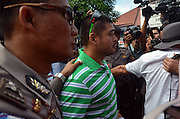 CILACAP, INDONESIA - APRIL 28: <br /> <br /> Ambulances Carrying Coffins For Death Penalty<br /> <br />  Michael Chan brother of Andrew Chan at Wijayapura port on April 28, 2015 in Cilacap, Central Java, Indonesia.<br /> Condemned Bali Nine duo Andrew Chan and Myuran Sukumaran have been given 72 hours execution notice. The execution could be held as soon as Tuesday midnight on Nusukamban Island where they have been held, awaiting there fate since March 4th, 2015. Chan and Sukumaran were both sentenced to death after being found guilty of attempting to smuggle 8.3kg of heroin valued at around $4 million from Indonesia to Australia along with 7 other accomplices.<br /> ©Himawan Nugraha/Exclusivepix Media