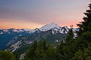 Smoke from forest fires creates a colourful sunset over Mount Baker in the Mount Baker-Snoqualmie National Forest, Washington State, USA .