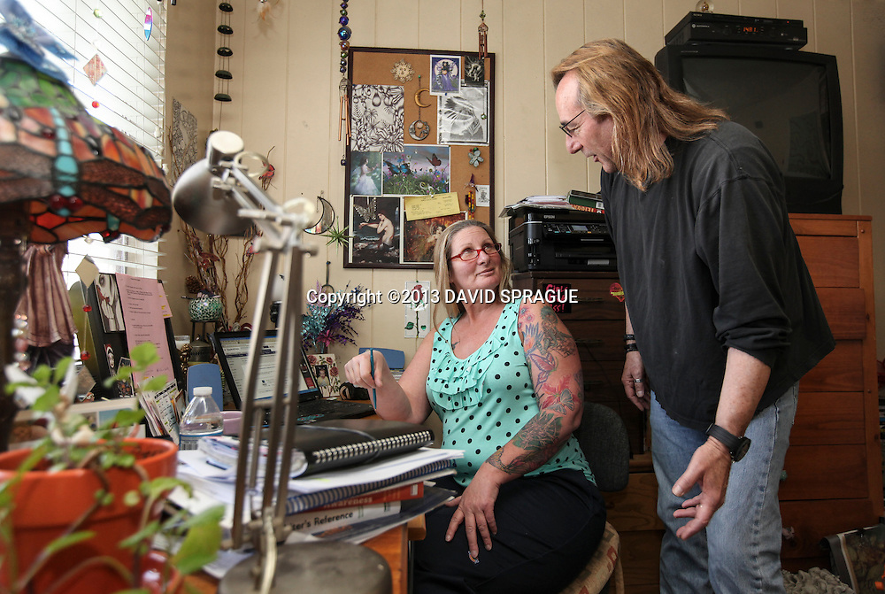 House Director Barbara Bali and Cary Nadler, president of Vesper House discuss business in office of the residential halfway house.  Nadler is the developer of the Center for Living and Learning as well.  Shot Feb. 25,  2013 Photo by David Sprague ©2013