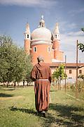 Monk walking inside II Redentore's gardens, Giudecca District. Venice, Italy, Europe