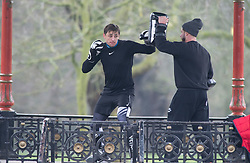 © Licensed to London News Pictures 15/01/2021.         Greenwich, UK. Two men doing mixed martial arts training in the Bandstand in Greenwich park, London during a third national Coronavirus lockdown. Photo credit:Grant Falvey/LNP