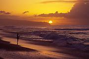 Fishing at sunset, North Shore, Oahu, Hawaii<br />