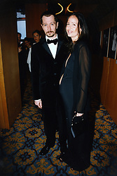 Gary Oldman and partner Donya Fiorentino arrive for the premiere of Oldman's directorial debut film 'Nil by Mouth', during the 50th Cannes Film Festival.