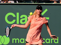 March 22, 2018 - Key Biscayne, FL, USA - Oceane Dodin of France returns against Simona Halep of Romania in the first round of the Miami Open in Key Biscayne, Fla., on Thursday, March 22, 2018. Halep advanced, 3-6, 6-3, 7-5. (Credit Image: © Pedro Portal/TNS via ZUMA Wire)