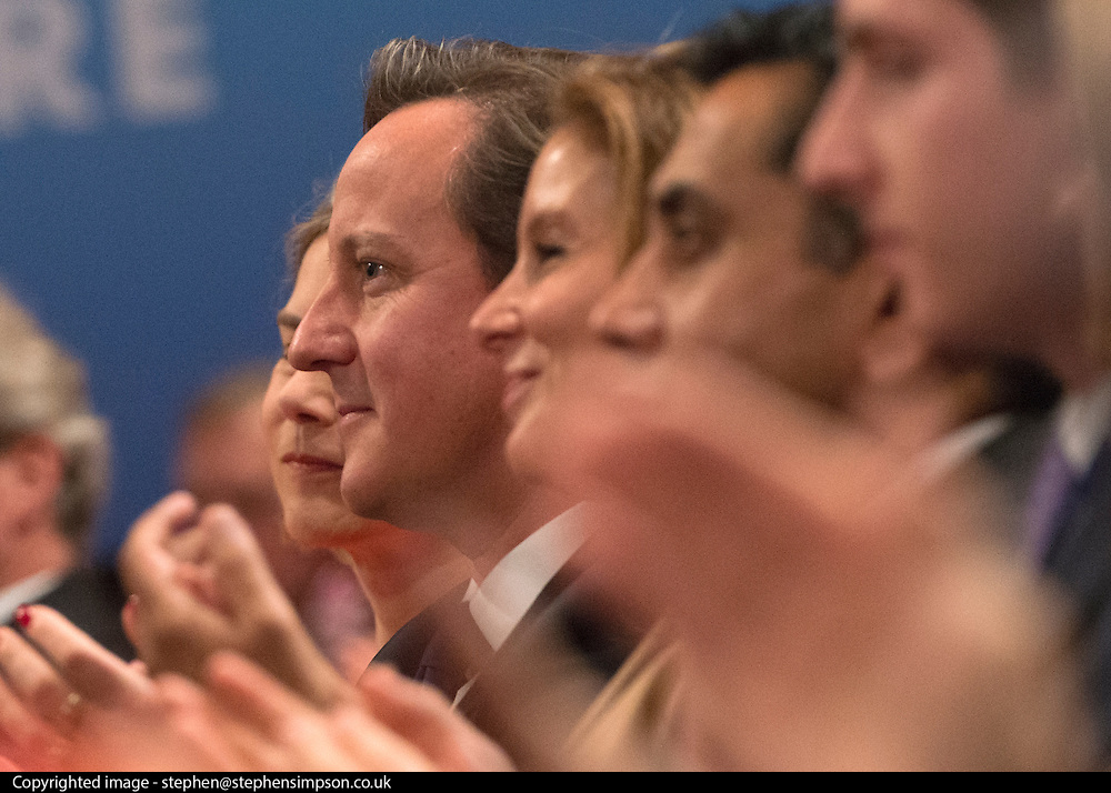 © Licensed to London News Pictures. 30/09/2014. Birmingham, UK. British Prime Minister David Cameron watches Boris Johnson's Mayor of London's speech.  The Conservative Party Conference in Birmingham 30th September 2014. Photo credit : Stephen Simpson/LNP