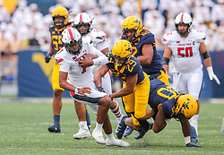 Oct 2, 2021; Morgantown, West Virginia, USA; Texas Tech Red Raiders quarterback Donovan Smith (7) runs the ball during the first quarter against the West Virginia Mountaineers at Mountaineer Field at Milan Puskar Stadium. Mandatory Credit: Ben Queen-USA TODAY Sports