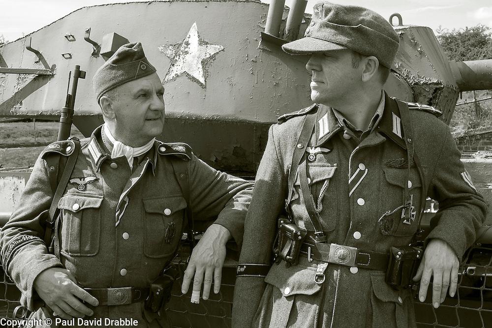 Reenactors portraying Members of 1 Kompanie Gro§deutschland beside one of the display tanks at Fort Paull<br /> <br />   04May 2015<br />   Image © Paul David Drabble <br />   www.pauldaviddrabble.co.uk