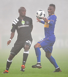 Cape Town 180314.Cape Town City midfielder Teko Modise challenged by Musa Nyatama of Orland Pirates in  aNedbank  geme taking place at the Cape Town Stadium. Photograph:Phando Jikelo/AFRICAN NEWS AGENCY/ANA