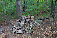 Vernon, New Jersey - This cairn or rock pile marks the spot to take the blue trail on the left to Pinwheel Vista on Wawayanda Mountain. The  Appalachian Trail continues on the right.
