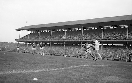 GAA All Ireland Senior Football final Kerry v. Galway 27th September 1964 at Croke Park..Galway goalie J. Gereghty takes flying kick at the ball to save in front of the goalmouth, with J.J. Barrett (Kerry) and E. Colleran (Galway) close by... *** Local Caption *** It is important to note that under the COPYRIGHT AND RELATED RIGHTS ACT 2000 the copyright of these photographs are the property of the photographer and they cannot be copied, scanned, reproduced or electronically stored in any form whatsoever without the written permission of the photographer