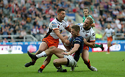 Castleford Tigers Paul McShane and Jy Hitchcock tackle Leeds Rhino's Matt Parcell during the Betfred Super League, Magic Weekend match at St James' Park, Newcastle.