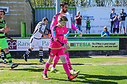 Forest Green Rovers goalkeeper Sam Russell(23) walks out with one of the mascots during the Vanarama National League match between Forest Green Rovers and Maidstone United at the New Lawn, Forest Green, United Kingdom on 22 April 2017. Photo by Shane Healey.