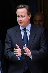 © Licensed to London News Pictures. 23/06/2015. London, UK. DAVID CAMERON leaving Downing Street at the launch of the Start-Up Britain campaign routemaster bus in Downing Street, London with Prime Minister, David Cameron. Over five weeks the routemaster bus will visit 30 towns and cities - including Aberdeen, Inverness, Swansea York and Leeds - and aim to engage with 15,000 individuals through workshops and networking events, making them aware of the assistance Start-Up Britain can offer. Photo credit : Vickie Flores/LNP