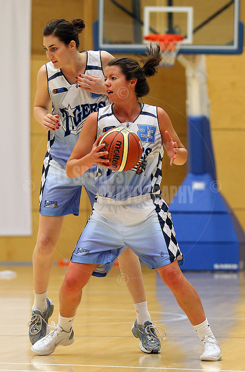 PERTH, AUSTRALIA - JULY 16: Kate Malpass of the Tigers looks to pass the ball during the week 18 SBL game between the Perry Lakes Hawks and the Willetton TIgers at The State Basketball Center on July 16, 2011 in Perth, Australia.  (Photo by Paul Kane/All Sports Photography)