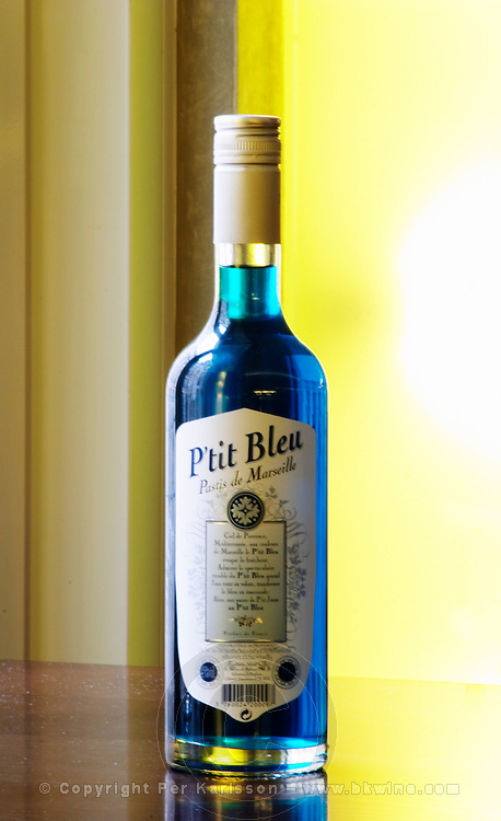 P'tit Ptit Bleu Pastis de Marseille Pastis is a spirit high alcohol drink flavoured flavored with herbs such as anise (badiane, anis étoilé etoile) and other spices. It is sometimes called pastis or Absinth absinthe. It is served in a tall glass with ice and you pour water on it. It gets cloudy milky when water is added. It is a favourite drink aperitif in Provence Southern France.