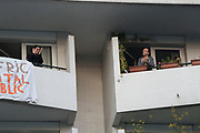 """April, 1st 2020 - Paris, Ile-de-France, France: Parisians sing and clap praises to the healthworkers at 8pm, isolated, in the hope of protecting themselves from the spread of the Coronavirus, during the twelfth day of near total lockdown imposed in France. A week after President of France, Emmanuel Macron, said the citizens must stay at home for at least 15 days, that has been extended. He said """"We are at war, a public health war, certainly but we are at war, against an invisible and elusive enemy"""". All journeys outside the home unless justified for essential professional or health reasons are outlawed. Anyone flouting the new regulations is fined. Nigel Dickinson"""
