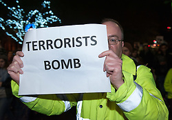 © Licensed to London News Pictures. 02/12/2015. Bristol, UK.  A  man holding placard appearing to be critical of terrorists rather than Governments bombing, at a rally and protest in Bristol city centre, to demonstrate against bombing 'Islamic State' in Syria, on the day the UK Parliament debates a motion for the UK to join in air strikes against 'Islamic State', otherwise known as IS, ISIS, ISIL or Daesh in Syria. Photo credit : Simon Chapman/LNP