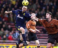 Fotball: Wimbledon David Connolly and Wolves Paul Butler.<br /><br />Foto: David Rawcliffe, Digitalsport