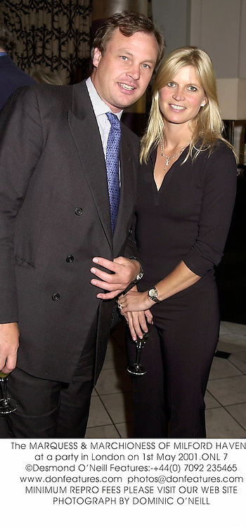 The MARQUESS & MARCHIONESS OF MILFORD HAVEN, at a party in London on 1st May 2001.ONL 7